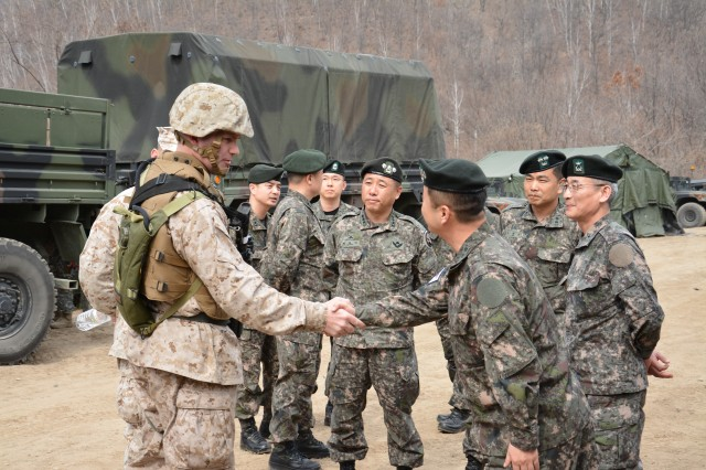 "CHEORWON, South Korea "" Col. Chris Lewis, from Lincoln Neb., the 1st Fires coordinator assigned to the III Marine Expeditionary Force, greet leaders from Republic of Korea 5000th Field Artillery Battalion at Rocket Valley near Cheorwon, South Korea March 26, 2014. (U.S. Army photo by Staff Sgt. Carlos R. Davis, 210th Field Artillery Brigade Public Affairs/Released)."