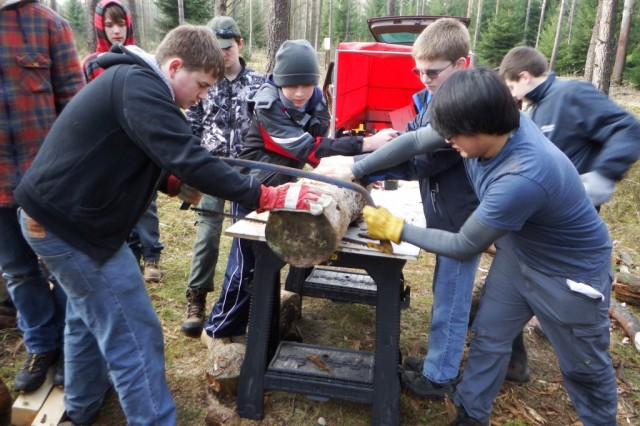 Harrison Marcouxbeatty (right, front) leads his team of volunteers in constructing a bug hotel during his Eagle Scout service project at USAG Bavaria, recently.