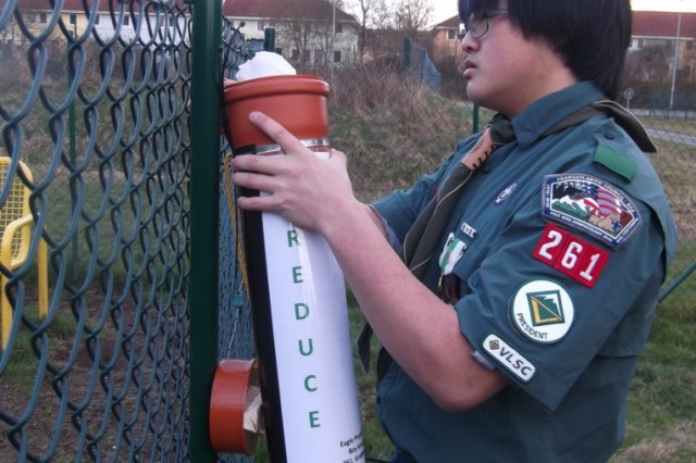 Harrison Marcouxbeatty installs a recycling container at the dog walk park on Rose Barracks as part of his Eagle Scout service project, March 24.