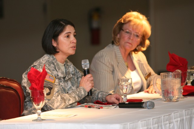 "Lt. Col. Maricela Alvarado, G3/5/7, U.S. Army Intelligence Center of Excellence, left, and Sierra Vista Council Woman Henrietta �""Hank"" Huisking, participate as panel members answering questions such as who was an inspirational person in their lives and what advice they might give to young women today, during the Women�'s History Month Observance at Thunder Mountain Activity Centre March 20."