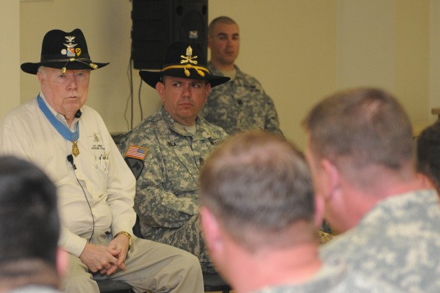 Col. (Retired) Bruce R. Crandall, Medal of Honor recipient for actions in the Ia Drang Valley in Vietnam, along with the 166th Aviation Brigade's Command Sergeant Major, Command Sgt. Maj. Glen Vela, recounts stories and gives advice to Soldiers of Troop B, 1st Squadron, 230th Air Cavalry Regiment, an OH-58D Kiowa Warrior helicopter unit of the Tennessee National Guard. The unit is going through post-mobilization training with the 166th's 1st Battalion (Training Support), 291st Aviation Regiment, before deploying to support operations in Afghanistan. (Photo by Capt. Tania Hummel, 166th Aviation Brigade, Division West Public Affairs)