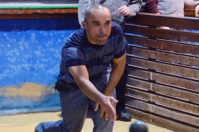 Spc. Grasiano Torres bowls during friendly rounds of bocce between townspeople and Soldiers from Bravo Co., BSB, 173rd Airborne at the Camisano bocciodromo March 15.