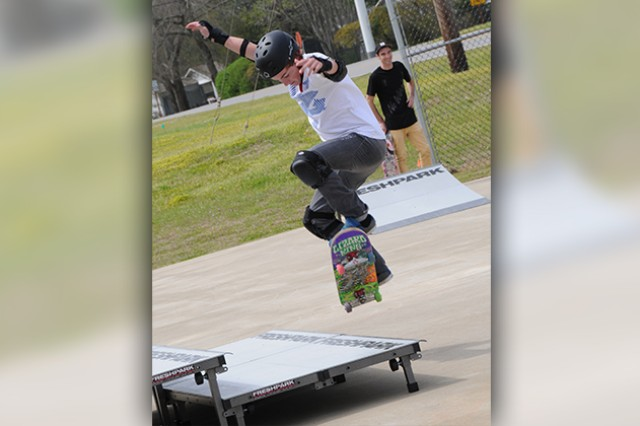 Zachary Francis, Army Family member, performs a trick at the new CYSS Skate Park during a grand opening ceremony at the Fort Rucker Youth Center March 24.