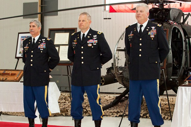 "CW5 George ""Billy"" Cook and CW5 Karl H. Maier stand with Col. John R. Evans Jr., 160th Special Operations Aviation Regiment during a retirement ceremony March 21 at Fort Campbell, Ky. Cook and Maier retired following a combined 70-years of service, with more than 50 years spent as Night Stalkers."