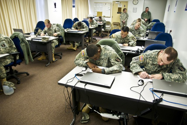 Army Reserve Soldiers from the 302nd Maneuver Enhancement Brigade and its downtrace units complete a written examination March 23, 2014, at Fort Devens, Mass. The exam was part of the MEB's best warrior competition held from March 23-28.