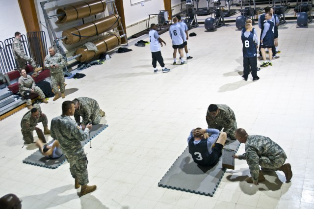 Army Reserve Soldiers participating in the 302nd Maneuver Enhancement Brigade's Best Warrior Competition participate in the Army Physical Fitness Test event at Fort Devens, Monday, March 24, 2014