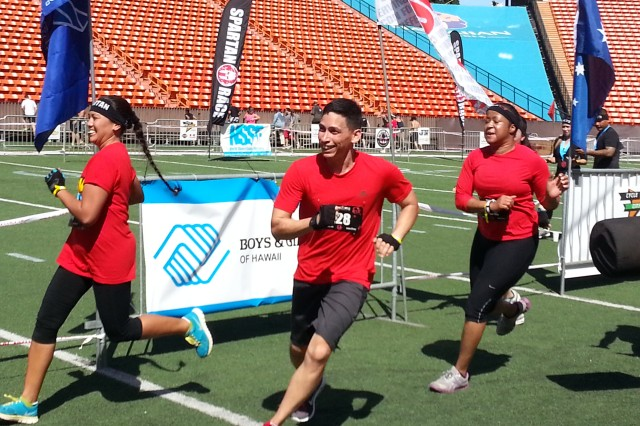 "(Left to right) Marlene Barretto, Lt. Col. Frankie Cruz and Sgt. 1st Class Rachel Harris lead the 413th Contracting Support Brigade ""Peacekeepers"" across the finish line at a  recent Spartan Race at Aloha Stadium, Hawaii."
