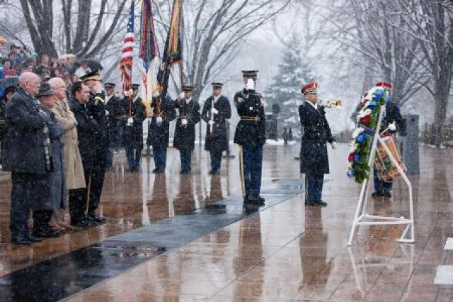 "Maj. Gen. Jeffrey S. Buchanan, Joint Force Headquarters-National Capital Region and Military District of Washington commanding general (right), and Medal of Honor recipients (from the left) Gary Beikirch, Hershel Williams, James Taylor and Clinton Romesha, render honors during the playing of ""Taps"" during a wreath-laying ceremony at the Tomb of the Unknowns in Arlington National Cemetery, Va., March 25, 2014. The wreath-laying was part of a larger Medal of Honor day recognition held at the cemetery."
