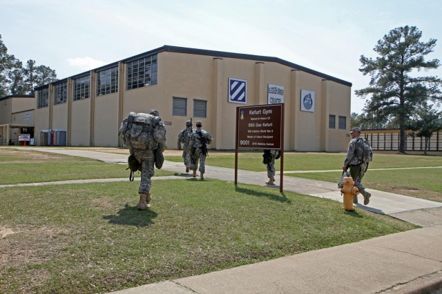 Soldiers with 1st Battalion, 15th Infantry Regiment, 3rd Armored Brigade Combat Team, 3rd infantry Division, head into Kefurt Gym on Kelley Hill, March 24, after being alerted of a civil support deployment as part of the brigade's Guardian Hammer. Guardian Hammer, March 24 - 28, was a brigade-wide Emergency Deployment Readiness Exercise conducted in Perry, Ga., and challenged soldiers in a variety of disaster response and civil support scenarios.