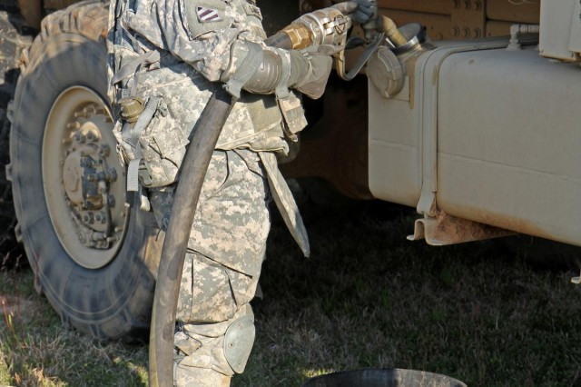 "Spc. Erika Savage, with Company F, 1st Battalion, 15th Infantry Regiment, 3rd Armored Brigade Combat Team, refuels a vehicle after the unit ""deployed"" from Fort Benning, Ga., to Perry, Ga., as part of Guardian Hammer."