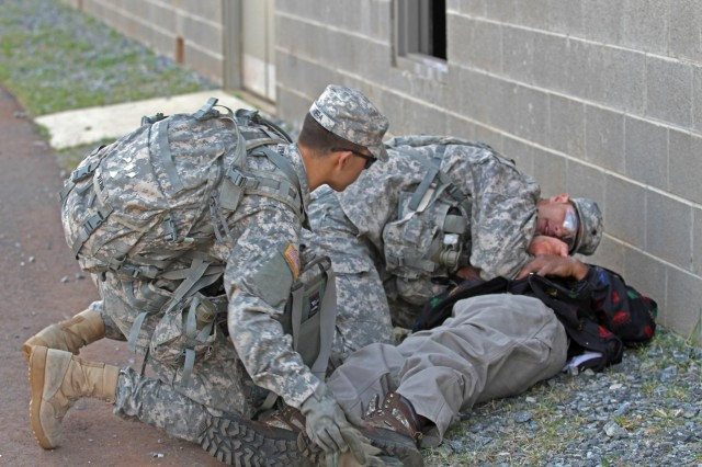 Medics with 1st Battalion, 15th Infantry Regiment, stabilize a simulated casualty and prepare a nine line MEDEVAC request, March 25, during the brigade's Emergency Deployment Readiness Exercise in Perry, Ga.