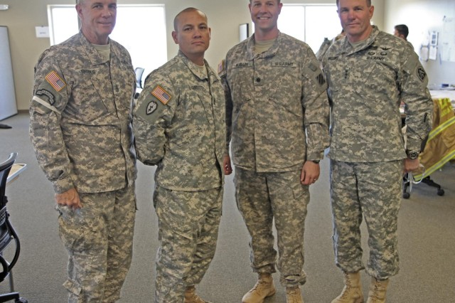 Command Sgt. Maj. Hu Rhodes (left), senior enlisted leader for U.S. Army North (Fifth Army), and Lt. Gen. Perry Wiggins (right), ARNORTH commanding general, pose for a photo with the command team of 1st Battalion, 15th Infantry Regiment, 3rd Armored Brigade Combat Team, March 26, inside the command center during Guardian Hammer. Guardian Hammer was a weeklong, brigade-level Emergency Deployment Readiness Exercise conducted in Perry, Ga. The 3rd ABCT, has been regionally aligned to support the U.S. Northern Command. Potential missions include responding to disasters and working with civil authorities. Active-duty military may conduct consequence management activities as part of a unified federal response when requested by a state.
