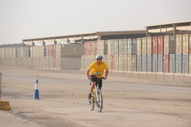 Sgt. Timothy Ahlers, Joint Tactical Ground Station engagement controller, Detachment B, 1st Space Company, competes in the bike portion of the Super Sprint event of the Camp As Sayliyah triathlon March 15. Ahlers placed third overall in the men?'s 30-39 age bracket.