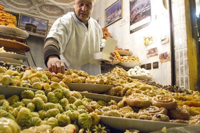 A vendor in the souks peddles homemade treats.