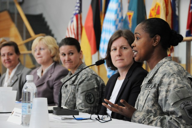 Sgt. Maj. Carolina Johnson, equal opportunity chief, U.S. Army Africa Command Vicenza, answers a question during the Empowering Young Women to Lead forum at U.S. Army Garrison Bavaria, March 28.