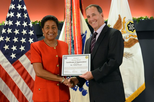 Tracey Pinson, director of the Army's Small Business Program, receives a certificate of appreciation presented by Gerald O'Keefe, administrative assistant to the secretary of the Army, at the Pentagon, March 31, 2014.