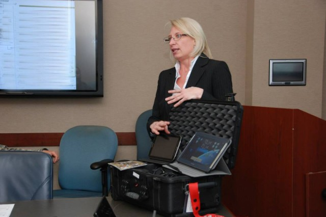 Lisa Prue, a military analyst with the U.S. Army Space and Missile Defense Command/Army Forces Strategic Command, explains the software applications of space kits during a Space NET Training and Fielding meeting hosted by the U.S. Army South Operations Directorate Mar. 19-20 at the Army South headquarters.