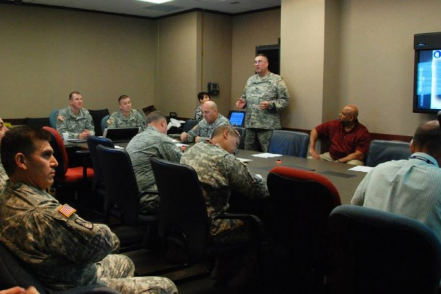 Lt. Col. Larry Roberts, U.S. Army South?'s chief of Space and STO, briefs attendants on Space NET Training and Fielding meeting hosted by the U.S. Army South Operations Directorate Mar. 19-20 at the Army South headquarters.