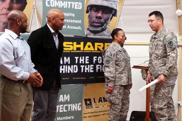Sgt. 1st Class Dennis Dutton, AFSBn-Kuwait, receives his graduation certificate from Chief Warrant Officer 3 Rennee Townsend, USARCENT senior SARC, Feb. 21 at Camp Arifjan, Kuwait. (Photo by Sgt. 1st Class Annette Simon, 402nd AFSB Public Affairs)