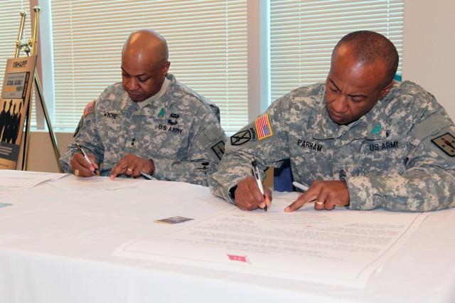 FORT LEE, Va. - Maj. Gen. Larry D. Wyche, Combined Arms Support Command and Fort Lee commanding general, and Command Sgt. Maj. Terry E. Parham, Sr., CASCOM and Fort Lee command sergeant major, signed a proclamation designating the official start of Sexual Assault Awareness Month April 1. Wyche, addressing the attendees, stated that it feels great to be part of a team that is taking the lead in the prevention of sexual assault and sexual harassment. (U.S. Army photo by Keith Desbois, Combined Arms Support Command Public Affairs.)