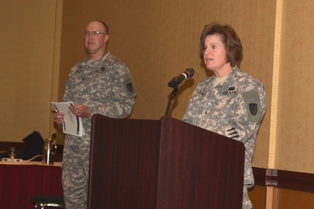 Brig. Gen. Kristin K. French, JMC commander and JM&L LCMC commander provides JASR opening remarks as Col. Benjamin Nutt, JMC chief of staff, stands by to provide administrative guidance.