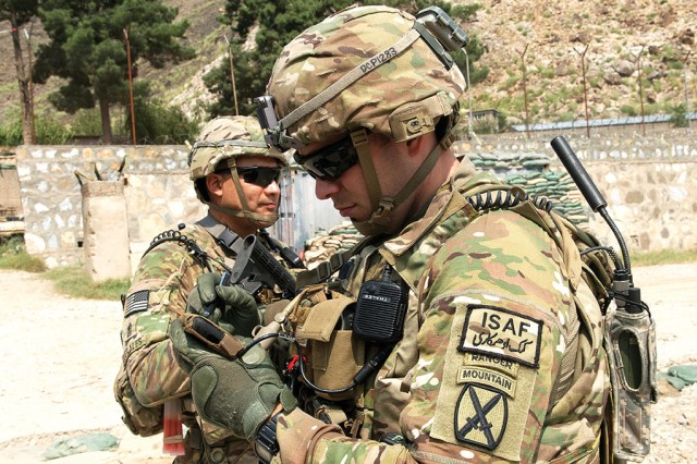Capt. Jonathan Page of the 4-10 MTN uses the Nett Warrior device connected to a Rifleman Radio at Nangalam Base, Afghanistan. The Army is conducting a full and open competition for the full-rate production phases of the Rifleman and Manpack radio programs.