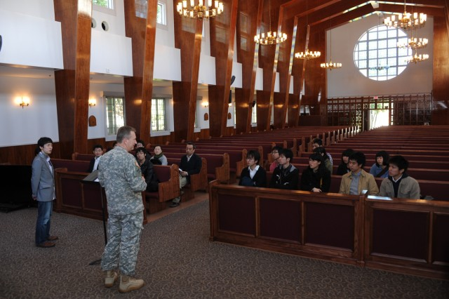 Lt. Col. Dallas Walker, the U.S. Army Garrison Japan chaplain, brief students and staff members from the Japanese Christian Student Association about different aspects of military chaplaincy and his own personal experiences on March 24 during a recent visit to the Camp Zama installation.