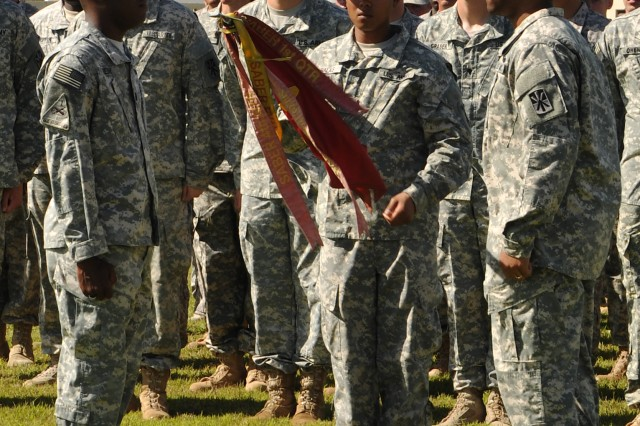 Cpt. Juan Remy, commander (left), and 1st Sgt. Quorey Joseph, senior enlisted leader (right), both of Alpha Battery, 4th Air Defense Artillery Regiment (A-4), face each other in front of a troop formation as they prepare to begin casing their unit�'s guidon in a Transfer of Authority ceremony, Apr.1, 2014 at Andersen Air Force Base, Guam.  The ceremony signaled the end of A-4�'s year-long deployment to Guam while A-2 assumed responsibility for the defense of Guam by uncasing its guidon. (Photo by SrA Cierra Presentado, 36th Wing Public Affairs Office)