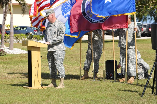 Lt. Col. Clyde Cochrane, commander, Task Force Talon, provides remarks to the Soldiers of Alpha Battery, 4th Air Defense Artillery Regiment (A-4) and Alpha Battery, 2nd Air Defense Artillery Regiment (A-2) during a Transfer of Authority ceremony between the two Alpha units Apr. 1, 2014 at Andersen Air Force Base in Guam. Cochrane said in his speech that the Guam mission will become increasingly more important as the United States military continues to rebalance towards the Pacific theater of operations.  (Photo by SrA Cierra Presentado, 36th Wing Public Affairs Office)
