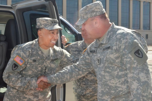 Maj. Gen. John Wharton, commanding general, Army Sustainment Command and RIA senior mission commander, welcomes Gen. Dennis Via, Army Materiel Command commanding general, to Rock Island Arsenal, Ill. March 31. Via, and a contingent of other military and civilian senior leaders from AMC, attended a roundtable discussion to showcase ASC's many capabilities, expound upon its growing international role, and tout its daily support to service members and their families around the globe.