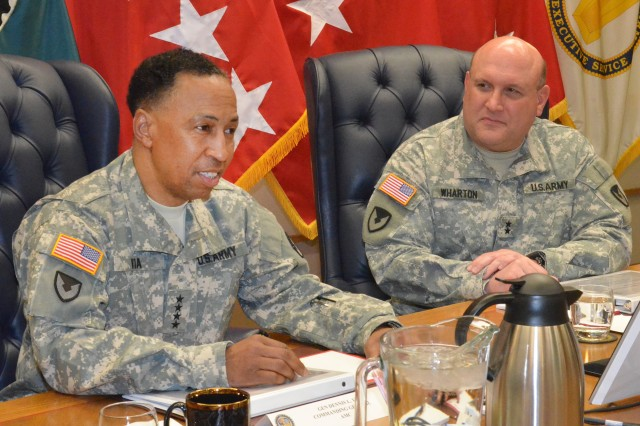 Gen. Dennis Via, Army Materiel Command commanding general, provides opening remarks as Maj. Gen. John Wharton, Army Sustainment Command commanding general and RIA senior mission commander, looks on during a roundtable discussion featuring military and civilian senior leaders from both commands at Rock Island Arsenal, Ill. March 31.