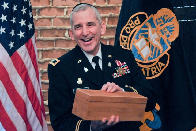 Col. Mark Sachs, command chaplain of the Army Reserve's 99th Regional Support Command, celebrates a 32-year Army career during his retirement ceremony March 7 at the Fort Magruder Hotel and Conference Center in Williamsburg, Va.