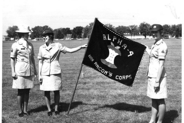 Drill Sergeant Hickman (left) and two members of the 88th Army Reserve Command's first all-female platoon stand on the Fort Snelling, Minn., parade ground after their homecoming ceremony from basic training, in August 1974. Hickman was selected by the Women's Army Corps to take charge, transport and personally facilitate the development of the 88th Army Reserve Command's first all-female platoon.