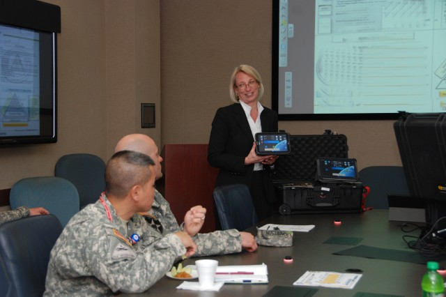 "JOINT BASE SAN ANTOINIO-FORT SAM HOUSTON, Texas �""Lisa Prue, a military analyst with the U.S. Army Space and Missile Defense Command/Army Forces Strategic Command, explains the software applications of space kits during a Space NET Training and Fielding meeting hosted by the U.S. Army South Operations Directorate Mar. 19-20 at the Army South headquarters."