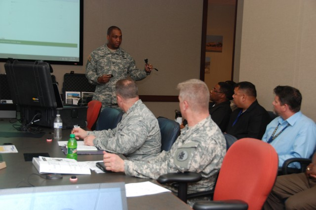 "JOINT BASE SAN ANTOINIO-FORT SAM HOUSTON, Texas �"" Col. Eric Handy, director of the Training and Exercise Division for U.S. Army Space and Missile Defense Command/Army Forces Strategic Command, explains the functions of the space kits during Space NET Training and Fielding meeting hosted by the U.S. Army South Operations Directorate Mar. 19-20 at the Army South headquarters."