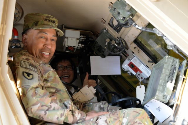 Gen. Dennis Via and the Hon. Heidi Shyu try out one of the display vehicles in one of AFSBn-Kuwait warehouses located at Camp Arifjan, Kuwait, March 16. (Photo by 1st Lt. Ryan Seidner, AFSBn-Kuwait)