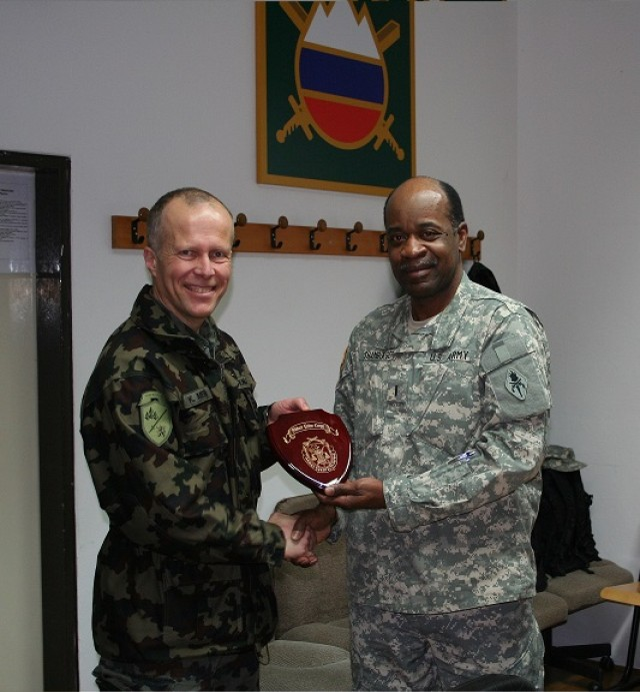 CW5 Leroy Shamburger presents a token of appreciation to Colonel Klemen Medja