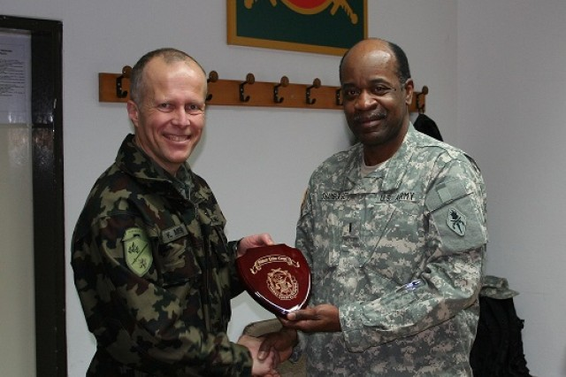 CW5 Leroy Shamburger (Right) presents a token of appreciation on behalf of USAMPS to Colonel Klemen Medja, general staff of Slovenian Armed Forces, for their hospitality and willingness to share ideas.