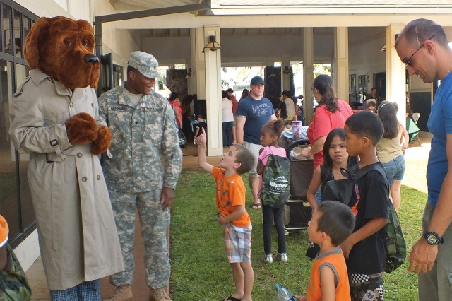 McGruff the Crime Dog greets young fans during IPCs' Live & Learn 101 Festival, held at the Kaena Community Center, March 19.