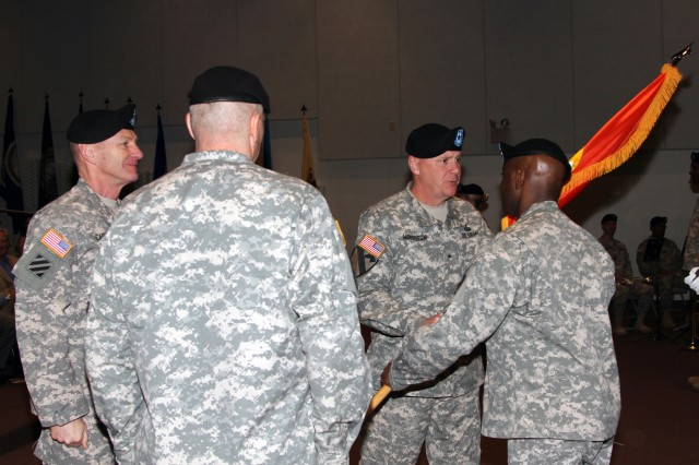 Brig. Gen. John B. Morrison Jr., incoming NETCOM Commanding General, passes the NETCOM flag to the command's command sergeant major, Command Sgt. Maj. Earl B. Allen, during the ceremony while Lt. Gen. Edward C. Cardon (far left), Army Cyber Command/2d U.S. Army Commanding General, and outgoing NETCOM commanding general, Brig. Gen. Peter A. Gallagher look on.