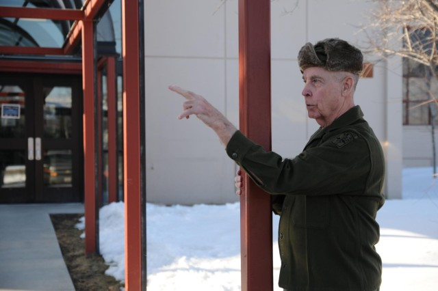 Retired U.S. Army Lt. Col. David Vozka recalls the violent rolling motion of the parking lot adjacent to the 4th Infantry Brigade Combat Team (Airborne), 25th Infantry Division's headquarters building March 27, 2014 at the exact time of day, 50 years after the Great Alaska Earthquake of 1964 hit at Joint Base Elmendorf-Richardson, Alaska. At the time of the quake, 4-25's headquarters building served as the Fort Richardson's Officers' Club. Vozka was a first lieutenant serving as the executive officer for Company C (Airborne), 4th Battalion, 23rd Infantry Regiment, 172nd Infantry Brigade and was shooting pool when the quake struck. (U.S. Army photo by Staff Sgt. Jeffrey Smith/Released)
