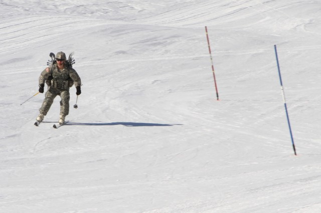 A Soldier with B Company, 3rd Battalion, 21st Infanrty Regiment, successfully completes the downhill slalom course with pack and gear at the end of an emergency response exercise at Fort Wainwright, Alaska. Soldiers from 3/21IN were alerted to participate in the state-wide Alaska Shield exercise and were given the mission of providing humanitarian aid supplies to an isolated population center.