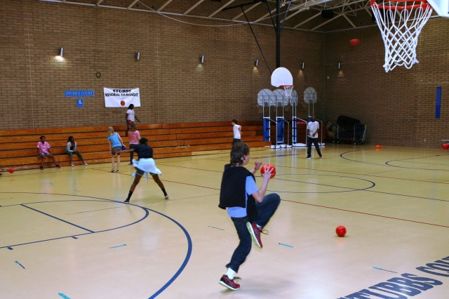 As part of the Middle School and Teen Program, kids play a friendly game of dodge ball in the multi-purpose gymnasium located inside the Youth Center.