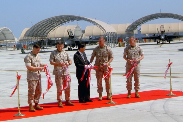 On March 27, 2014, a ceremony was held at Marine Corps Air Station Iwakuni to commemorate the opening of a new compound which features buildings and facilities for the Marine Aviation Logistics Squadron and Marine Aircraft Group 12.
