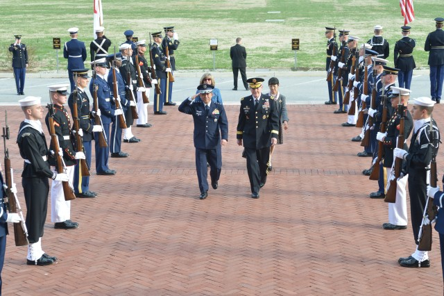 General Shigeru Iwasaki, Chief of Staff, Joint Staff, Japan Self-Defense Forces and Gen. Martin Dempsey, the chairman of the Joint Chiefs of Staff walk up the steps of the National Defense University, America's premier joint professional military education institution, during an official greeting ceremony held for the Japanese military leader at Fort Lesley J. McNair, April 3, 2014.