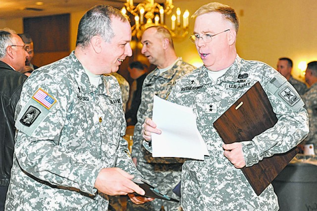 From left, Chap. (Maj.) Daryl Densford, visits with Chap. (Maj. Gen.) Donald Rutherford, U.S. Army Chief of Chaplains, March 27 at the National Prayer Breakfast.