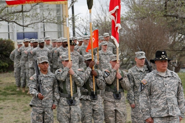 "Lt. Col. James Wills, the executive officer of the 91st �""Saber"" Brigade Engineer Battalion, 1st �""Ironhorse"" Brigade Combat Team, 1st Cavalry Division, presents the Saber color guard after its reflagging from the 1st �""Centurion"" Brigade Special Troops Battalion to the 91st BEB during a reflagging and change of responsibility ceremony March 26 at Fort Hood, Texas. The Engineer Song and The Army Song were played at the conclusion of the ceremony bidding farewell to Command Sgt. Maj. Daniel O�'Brien, the outgoing new senior noncommissioned officer, and welcoming Command Sgt. Maj. Derek Cuvellier, the incoming Saber senior NCO. (U.S. Army photo by Pfc. Paige Behringer, 1BCT PAO, 1st Cav. Div.)"