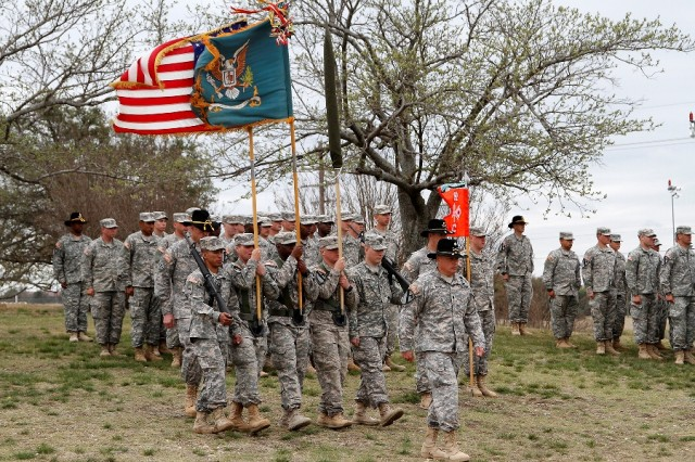 "Lt. Col. James Wills, the executive officer of the 91st ?""Saber"" Brigade Engineer Battalion, 1st ?""Ironhorse"" Brigade Combat Team, 1st Cavalry Division, marches the Saber color guard during a reflagging and change of responsibility ceremony March 26 at Fort Hood, Texas. The 1st ?""Centurion"" Brigade Special Troops Battalion was constituted as the 91st BEB and was officially reflagged. On the same day, Command Sgt. Maj. Daniel O?'Brien, Saber?'s outgoing senior noncommissioned officer, handed the reins over to Command Sgt. Maj. Derek Cuvellier. (U.S. Army photo by Pfc. Paige Behringer, 1BCT PAO, 1st Cav. Div.)"