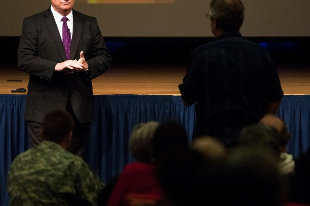 Eric Hipple, former Detroit Lions quarterback, takes questions after speaking about suicide prevention at the Pentagon March 27, 2014. Hipple, who lost his son to suicide in 2000, speaks to audiences and has written a book about his experience. (Joint Base Myer-Henderson Hall PAO photo by Rachel Larue)