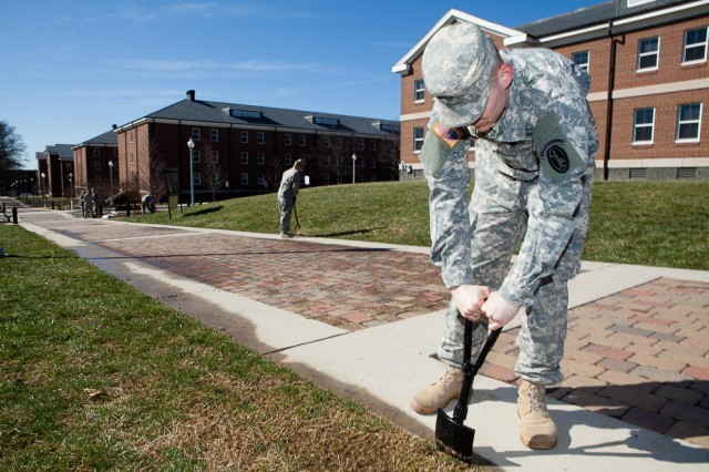 Pfc. Frank Smith, 289th Military Police Company, 3rd U.S. Infantry Regiment (The Old Guard), takes part in spring cleanup on Joint Base Myer-Henderson Hall March 31, 2014. In addition to the clean up, JBM-HH officials are encouraging safety through a spring safety campaign.